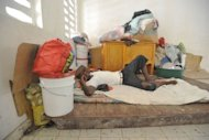 A man left homeless by Hurricane Sandy lies amid his belongings in the Nippes region of Haiti on November 17. Hurricane Sandy, the deadly storm that slammed into New York and New Jersey in October, tore through the Caribbean long before reaching America -- and in Haiti, many still await help