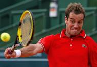 France's Richard Gasquet returns the ball to Spain's Daniel Nava during their Estoril Open tennis tournament quarter-final match in Oeiras, on the outskirts of Lisbon. Gasquet won 7-6, 6-2