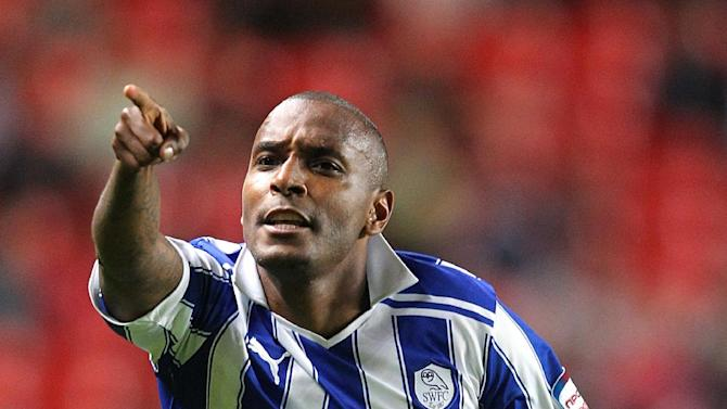 Clinton Morrison has penned a two-year deal with Colchester