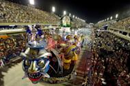 Revelers of the Inocentes de Belford-Roxo samba school perform during the first night of Carnival parade at the Sambadrome in Rio de Janeiro, Brazil on February 10, 2013. Inocentes pays tribute to the 50th aniversary of South Korean immigration to Brazil