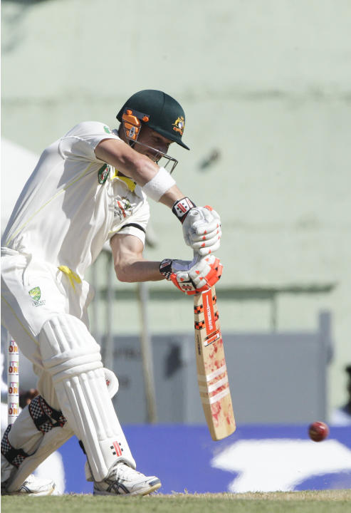 Australia's batsman David Warner plays a shot against the West Indies' during the opening day of their first cricket Test match in Roseau, Dominica, Wednesday, June 3, 2015. (AP Photo/Arnulfo