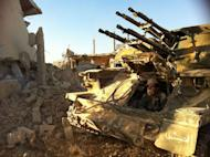 """A Syrian army soldier sits in his tank in the southwestern neighborhood of the Syrian city of Qusayr. France said Tuesday it has proof that President Bashar al-Assad's regime was using the deadly nerve agent sarin gas in Syria's civil war, adding """"all options,"""" including armed intervention, were on the table"""