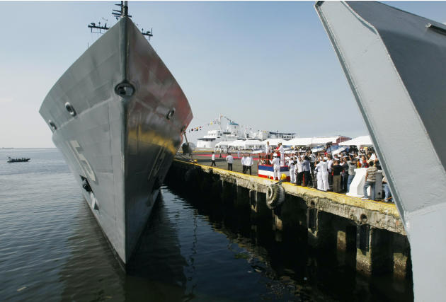 Philippine President Benigno Aquino III and his sister Maria Elena Aquino-Cruz, on the platform, lead the Christening and Commissioning ceremony of the country's newly-acquired Hamilton class warship