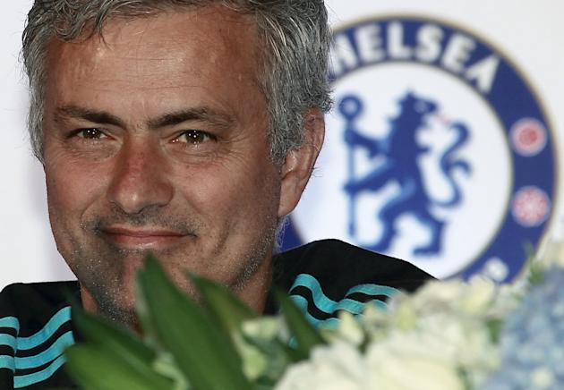 Chelsea manager Mourinho smiles during a news conference in Bangkok