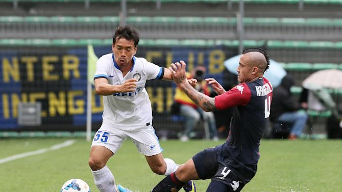 Inter Milan Japanese defender Yuto Nagatomo, left, is takcled by Cagliari's Radja Nainggolan, during the Serie A soccer match between Cagliari and Inter, at the Nereo Rocco Stadium in Trieste, Italy, Sunday, Sept. 29, 2013