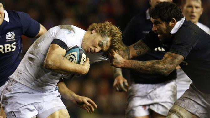 Scotland's Jim Hamilton tackles England's Billy Twelvetrees during their Six Nations rugby union match at Murrayfield Stadium in Edinburgh