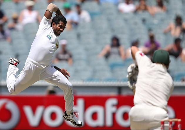 MELBOURNE, AUSTRALIA - DECEMBER 27: Dhammika Prasad of Sri Lanka misses a caught and bowled chance against Shane Watson of Australia during day two of the Second Test match between Australia and Sri L