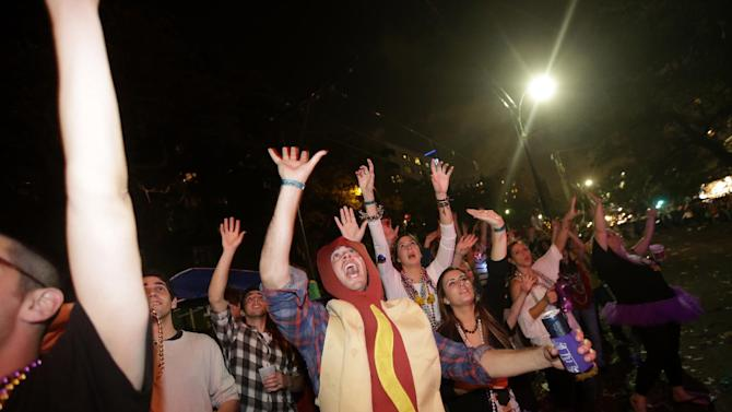 Revelers yell for beads and trinkets during the Krewe of Bacchus Mardi Gras parade in New Orleans, Sunday, Feb. 10, 2013. (AP Photo/Gerald Herbert)