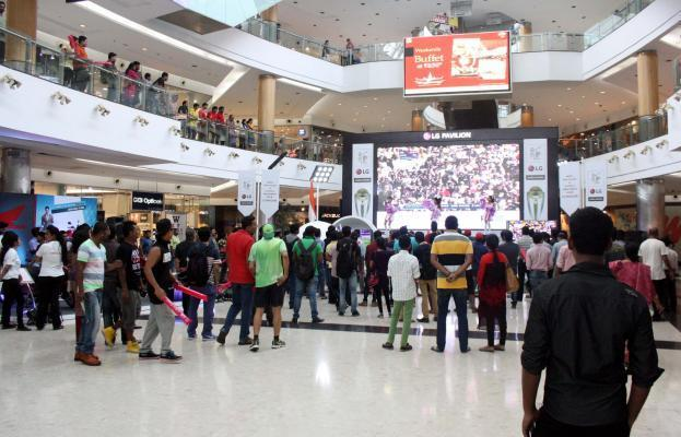 Cricket fans watch the final match of ICC World Cup 2015 between Australia and New Zealand in a Kolkata shopping mall, on March 29, 2015. (Photo: IANS)