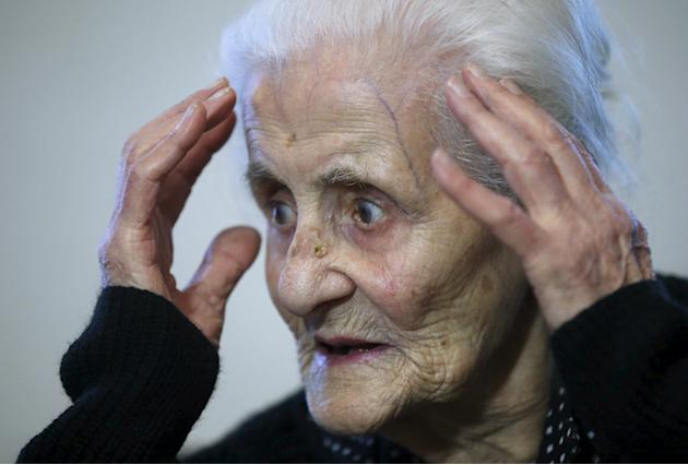 Atajyan, 103, gestures during an interview with Reuters at home in Yerevan