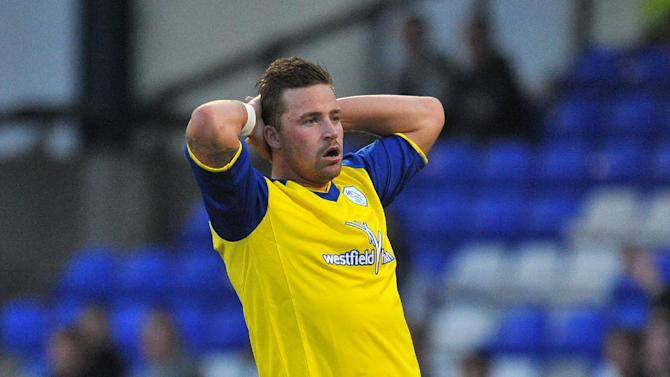 Chris Maguire's loan move to Portsmouth has been scuppered by a knee injury