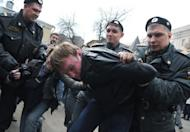 Police officers detain a supporter of female Russian punk band Pussy Riot outside a court in Moscow on Thursday. The court extended until late June the pretrial detention of two young membersthe band whose stunt performance in Russia's main cathedral has drawn fury from the Church