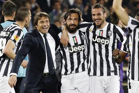 (From L-R) Juventus' coach Antonio Conte with players Andrea Pirlo and Daniel Pablo Osvaldo celebrate after defeating Fiorentina in their Europa League round of 16 second leg soccer match at Artemio Franchi stadium in Florence March 20, 2014. REUTERS/Giampiero Sposito
