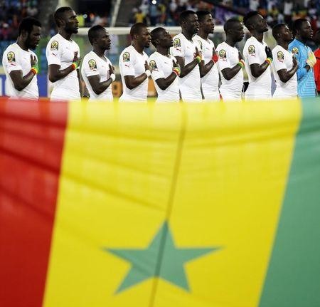 Senegal national soccer team players listen to their national anthem before the start of their Group C soccer match against Algeria in the African Cup of Nations in Malabo