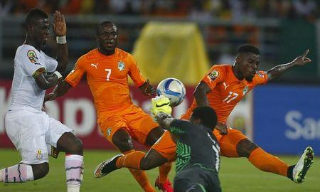 Ghana's goalkeeper Brimah Razak saves the ball against Ivory Coast's Serge Aurier and Seydou Doumbia during the African Nations Cup final soccer match in Bata