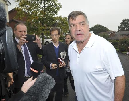 Former England soccer manager Sam Allardyce leaves his home in Bolton