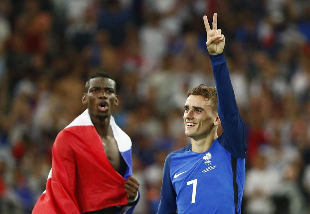 France's Paul Pogba and Antoine Griezmann celebrate at the end of the game