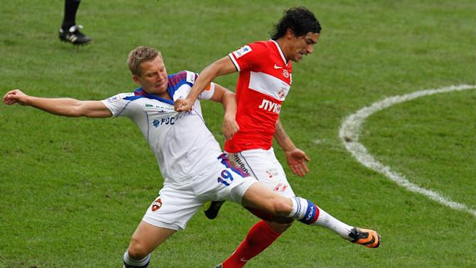 CSKA Moscow's Aleksandrs Cauna, left, vies for the ball with Spartek's Tino Costa during a Russian Premier League Championship soccer match between CSKA Moscow and Spartak Moscow at the Lokomotiv stadium in Moscow, Russia, Sunday, Sept. 22, 2013. Spartak won 3-0