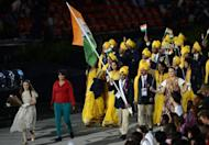 Madhura Nagendra (2L) walks with the Indian delegation including flagbearer Sushil Kumar during the opening ceremony of the London Olympic Games, July 27, 2012