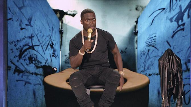 """In this image released by Universal Pictures, Kevin Hart performs in his comedy concert film, """"Kevin Hart: What Now?"""" (Universal Pictures via AP)"""