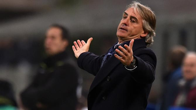 Mancini calls hoax over PSG links