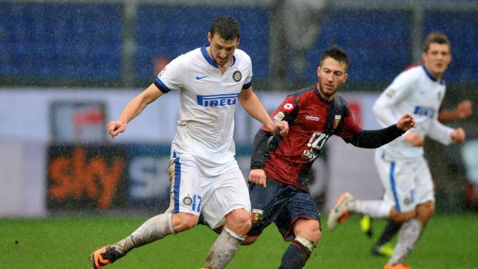 Inter of Milan's Zdravko Kuzmanovic, left, vies for the ball with Genoa's Andrea Bertolacci during a Serie A soccer match in Genoa's Luigi Ferraris Stadium, Italy, Sunday, Jan. 19, 2014