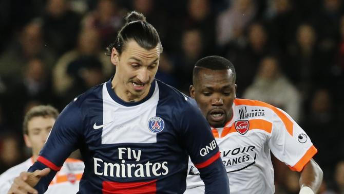 Paris Saint Germain's Zlatan Ibrahimovic fights for the ball with Valenciennes' Tongo Doumbia during their French Ligue 1 soccer match soccer match at Parc des Princes Stadium in Paris