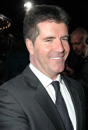 Simon Cowell Admits to Dating Carmen Electra: Other Ladies Who Have Caught His Eye