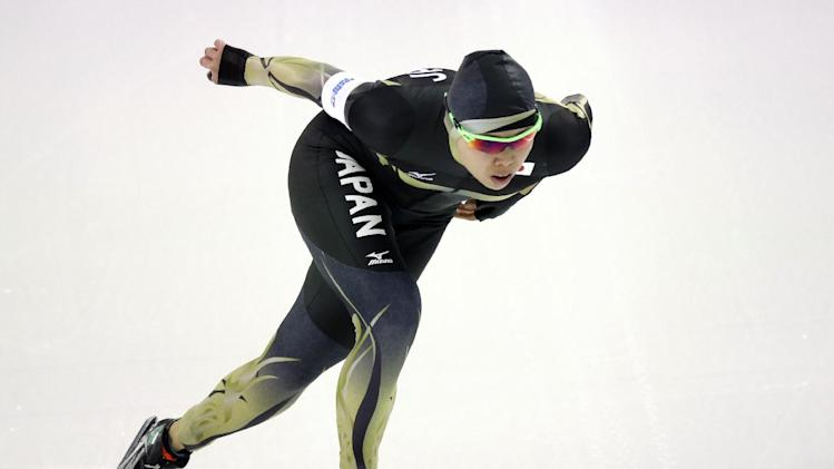 Maki Tsuji of Japan competes in the women's 1,000-meter speedskating race at the Adler Arena Skating Center during the 2014 Winter Olympics in Sochi, Russia, Thursday, Feb. 13, 2014