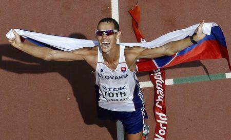 Matej Toth of Slovakia celebrates winning the men's 50 km race walk final during the 15th IAAF World Championships at the National Stadium in Beijing