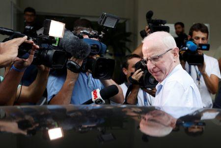 Former top European member of the International Olympic Committee (IOC), Patrick Hickey,  leaves a police station in Rio de Janeiro