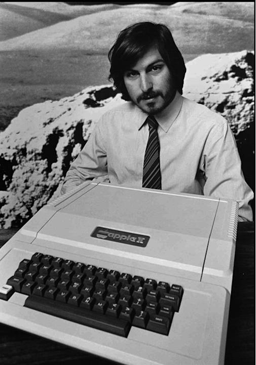 1977 - Photo shows Apple co-founder Steve Jobs as he introduces the new Apple II in Cupertino, Calif. Apple on Wednesday, Oct. 5, 2011 said Jobs has died. He was 56. (AP Photo/Apple Computers Inc., Fi