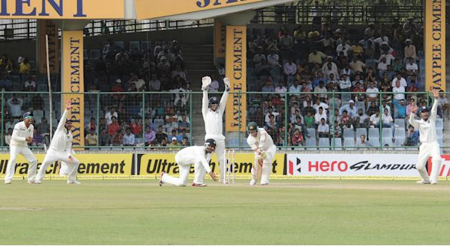 Steve Smith of Australia caught out by Ajinkya Rahane of India during the 4th test match of Border Gavaskar Trophy, at Ferozeshah Kotla Stadium in Delhi on March 22, 2013. P D Photo by P S Kanwar