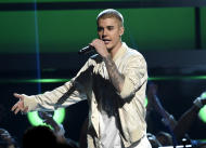 FILE - In this May 22, 2016 file photo, Justin Bieber performs at the Billboard Music Awards in Las Vegas. A Las Vegas man who says Bieber assaulted him in Cleveland eight months ago has filed a police report about the fracas. (Photo by Chris Pizzello/Invision/AP, File)