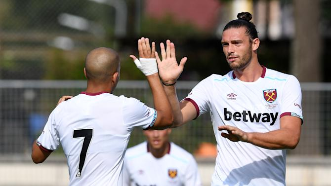 West Ham's Sofiane Feghouli and Andy Carroll celebrate after a goal