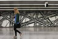 "A girl looks at her mobile phone in Vienna. Facebook has been ""one of the biggest offenders of users' privacy since the beginning,"" said John Simpson, privacy project director for Consumer Watchdog"