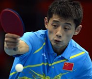 China's Zhang Jike serves to Turkey's Bora Vang during their table tennis match at the London 2012 Olympics on July 30. Zhang, the gold medal favourite, scotched suggestions that new regulations would challenge China's dominance of the Olympic table tennis tournament on Monday with an emphatic opening win