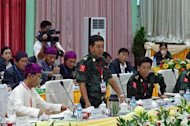 General Gwan Maw of the Kachin Independence Army speaks during a meeting with Myanmar government officials and a delegation of the rebel Kachin Independence Organization in Myitkyina, in the country's northern Kachin state on October 8, 2013