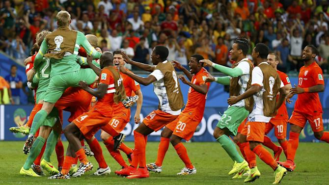 World Cup - Dutch edge through after dramatic shoot-out