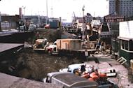 In this March 1964 photo released by the U.S. Geological Survey, Anchorage small business owners clear salvagable items and equipment from their earthquake-ravaged stores on shattered Fourth Avenue in Alaska in the aftermath of an earthquake. North America's largest earthquake rattled Alaska 50 years ago, killing 15 people and creating a tsunami that killed 124 more from Alaska to California. The magnitude 9.2 quake hit at 5:30 p.m. on Good Friday, turning soil beneath parts of Anchorage into jelly and collapsing buildings that were not engineered to withstand the force of colliding continental plates. (AP Photo/U.S. Geological Survey)