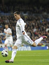 Real Madrid's Cristiano Ronaldo shoots on the Sevilla goal, at the Santiago Bernabeu stadium on February 9, 2013. The Spanish champions take on Manchester United on Wednesday in the first leg of their Champions League last-16 tie