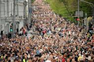 """Thousands of Russian opposition supporters attend a rally against President Vladimir Putin in central Moscow in May 2012. A new law allows Russia authorities to punish de facto organisers of informal """"walking protests"""" that have been recently used by the opposition, under the vague definition of """"being en masse simultaneously"""""""
