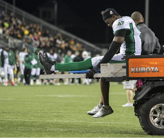 Roughriders defensive lineman Alex Hall leaves the game injured during their CFL football game in Hamilton against the Tiger-Cats