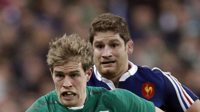 Ireland's Andrew Trimble, front, runs with the ball followed by France's Pascal Pape during the Six Nations Rugby Union match between France and Ireland at the stade de France stadium, in Saint Denis, outside Paris, Saturday, March 15, 2014
