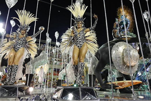 Performers from the Salgueiro samba school parade on a float during carnival celebrations at the Sambadrome in Rio de Janeiro, Brazil, Monday, Feb. 16, 2015. (AP Photo/Leo Correa)