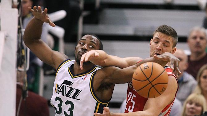 Utah Jazz's Mike Harris (33) and Houston Rockets' Chandler Parsons (25) battle for a rebound in the second half during an NBA basketball game Saturday, Nov. 2, 2013, in Salt Lake City. The Rockets defeated the Jazz 104-93