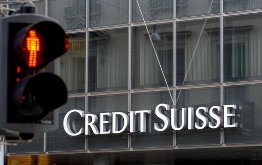 A traffic light pictured in front of a sign of Swiss bank Credit Suisse in Basel, Switzerland on June 11, 2013