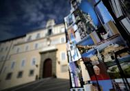 Postcards are displayed on February 20, 2013 outside a souvenir shop by the Apostolic Palace on the main square of Castel Gandolfo, Italy. Some cardinals have cautioned that since there are no clear favourites for the succession this time around, the conclave could take longer than the two days it took them to elect Pope Benedict