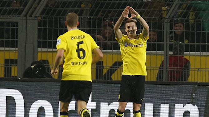 Dortmund's Marco Reus, right, celebrates scoring during the German first division Bundesliga soccer match between  BvB Borussia Dortmund and VfB Stuttgart  in Dortmund, Germany, Friday, Nov. 1, 2013