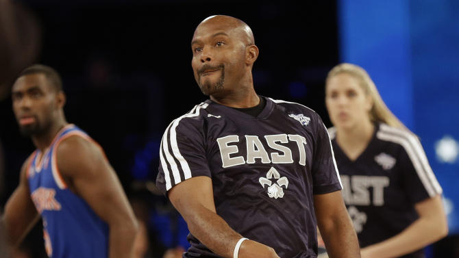 Former NBA player Tim Hardaway Sr. watches his shot during the skills competition at the NBA All Star basketball game, Saturday, Feb. 15, 2014, in New Orleans. (AP Photo/Gerald Herbert)